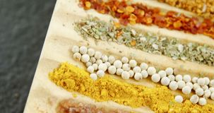 Various spices arranged in tray 4k. Close-up of various spices arranged in tray 4k stock footage