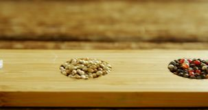 Various spices in wooden tray 4k. Close-up of various spices in wooden tray 4k stock footage
