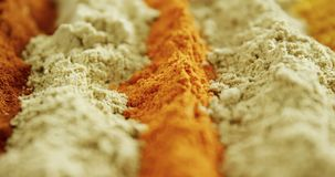 Various type of spice powder on tray 4k. Close-up of various type of spice powder on tray 4k stock video