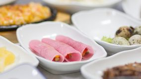 Vegetable wrap among other Korean side dishes. A close up of vegetable wrap among other Korean Cuisine Side Dishes royalty free stock images