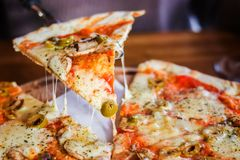 Close-up. Vegetarian pizza on a dark background stock photo