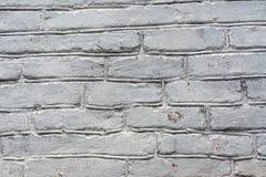 Close-up velho da parede de tijolo pintado branco fotografia de stock