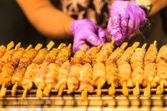 Close up the vendor grilling pork satay, Thai steak roasted pork Stock Photos