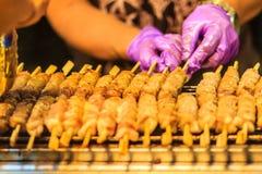 Close up the vendor grilling pork satay, Thai steak roasted pork Royalty Free Stock Photo