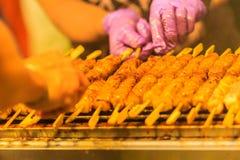 Close up the vendor grilling pork satay, Thai steak roasted pork Stock Images