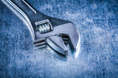 Close up version of stainless adjustable spanner on scratched me Royalty Free Stock Image