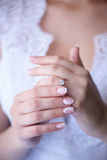 Bride showing proudly the wedding or engagement ring Royalty Free Stock Photos