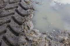 Tractor Tracks Over Muddy Water stock photos