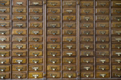 Close-up of a very old apothecary cabinet. Made form wood royalty free stock image