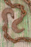 Heavy hook. Close up of very rusty hook and chain Royalty Free Stock Photos