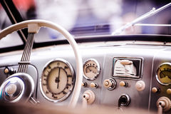 Close up of veteran car, dashboard, windshield, steering wheel. Sunny summer day Royalty Free Stock Photography