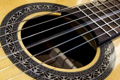 Close up on a vibrating string of a guitar royalty free stock photo