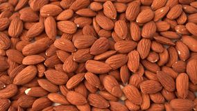 Almonds close up, view from the above, food background,. Close up video almonds, top view with panning effect stock video footage