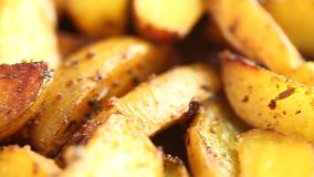 Video fried in ghee with spices pieces of potatoes stock video footage