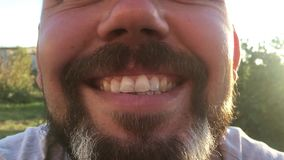 Close up video of perfect male teeth. Smiling bearded hipster man looking at camera. Close up video of perfect male teeth. Smiling bearded hipster man looking stock video