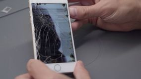 Close-up video showing process of mobile phone repair. IPhone LCD crashed stock footage