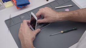 Close-up video showing process of mobile phone repair