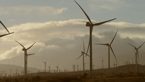 The close-up video of simultaneous operation of windmills stock footage