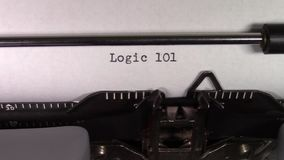 The words `Logic 101 ` being typed on a typewriter
