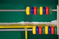 Close up view of abacus scores mental arithmetic with colorful back to school supplies over white table. Space for text. Flat lay. Style Royalty Free Stock Photography