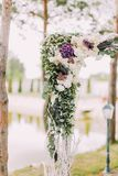 Close-up view of the above part of the wedding arch decorated with colourful flowers and herbs. Close-up view of the above part of the wedding arch decorated Stock Images