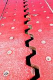 Close up view from above of an red iron dilatation joint placed royalty free stock photography