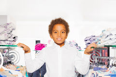 Close-up view of African boy in clothes store Royalty Free Stock Image