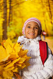 Close up view of African girl with leaves bunch Royalty Free Stock Photos