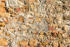 Close up view of an aged textured plastered stone wall Stock Photography