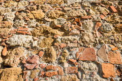 Close up view of an aged textured stone wall Stock Photos