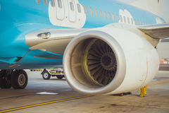 Close up view of airplane turbine engine while it being preparin Stock Photos