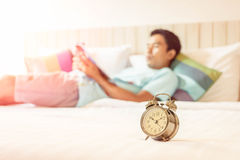 Close up view of alarm clock in morning bedroom environment Stock Photo