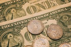 Close up view of American dollar bills and coins as background. Heap of American dollars for design.