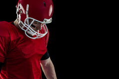 Close up view of american football player focusing Royalty Free Stock Photo