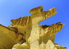A close up view of limestone cliffs against blue sky royalty free stock photos