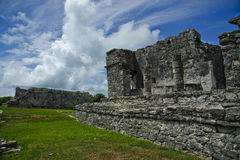 Close up view of the ancient temple in Tulum Mexico. Tulum has architecture typical of Maya sites on the east coast of the Yucatan Peninsula. This architecture Royalty Free Stock Image