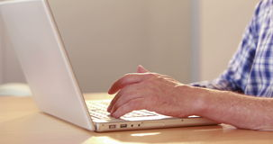 Close up view of angry casual businessman using laptop. In the office stock footage