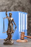 Close-up view of antique statue of lady justice on wooden table. Law concept stock photos