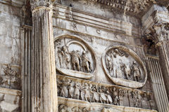 Close up view of arch of Constantine. (Arco di Costantino) A 21m-high Roman structure made up of 3 arches decorated with figures & battle scenes in Rome / Italy Stock Photo