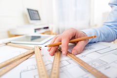 Close up view of an architect working at office Stock Photos