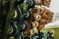Close up view of arranged roller skates in indoors. Skate park royalty free stock photography