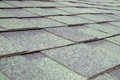 Close up view on asphalt roofing shingles Stock Image