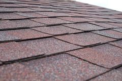 Close up view on asphalt roofing shingles Royalty Free Stock Photography