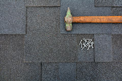 Close up view on Asphalt Roofing Shingles Background. Roof Shingles - Roofing. Asphalt Roofing Shingles Hammer and Nails Stock Photos