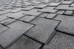 Close up view on Asphalt Roofing Shingles Background. Roof Shingles - Roofing. Roof shingles covered with frost Royalty Free Stock Image