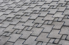 Close up view on Asphalt Roofing Shingles Background. Roof Shingles - Roofing. Roof shingles covered with frost Stock Photo