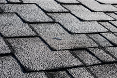 Close up view on Asphalt Roofing Shingles Background. Roof Shingles - Roofing. Roof shingles covered with frost Royalty Free Stock Photography