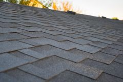 Close up view on asphalt roofing shingles. royalty free stock photography