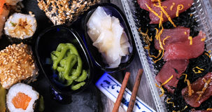 Close up view of an assortment of Japanese food: sushi, nigiri, sashimi Royalty Free Stock Photo