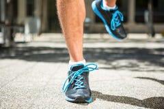 Close up view of athletes feet jogging Stock Photos